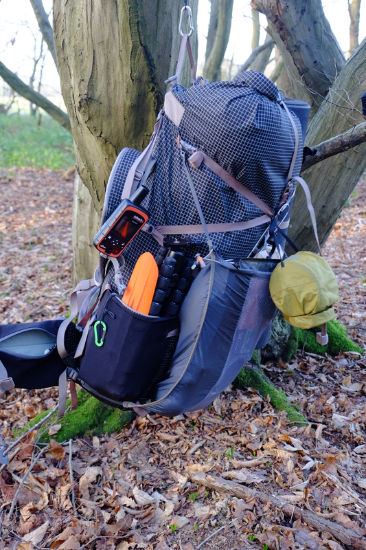 Backpack hanging in tree.