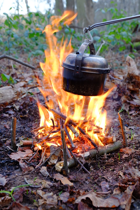 Pot over camp fire